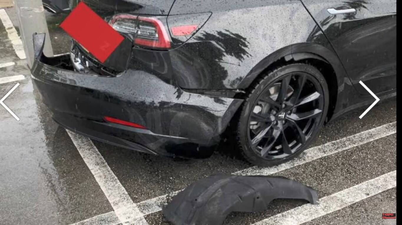 Тесла Модел 3 осталась без бампера после сильного дождя.