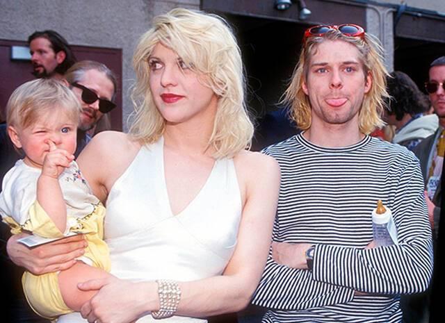 Кортні Лав і Курт Кобейн з донькою