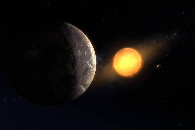 Kepler-1649c на тлі свого червоного карлика. Ілюстрація