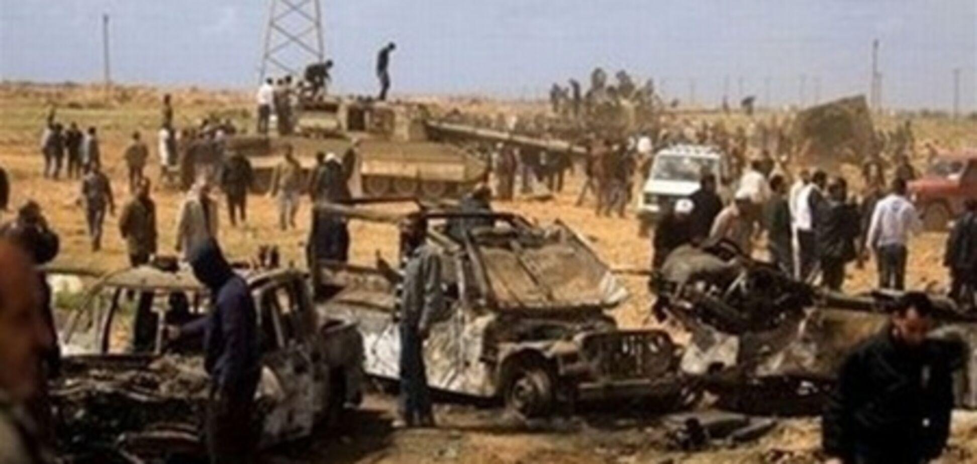 Противников Каддафи обвинили в военных преступлениях