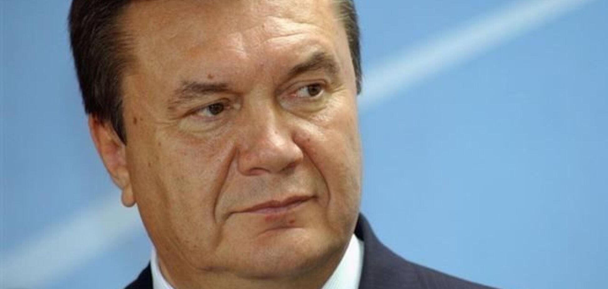 Янукович подписал законы об амнистии и об отмене 'законов 16 января'