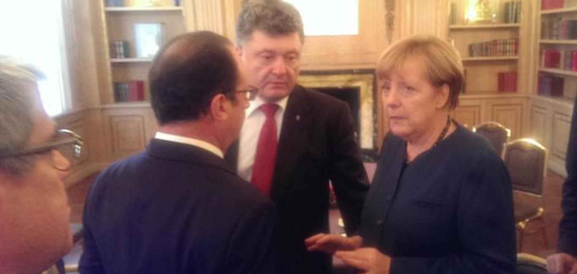 Путін залишив нараду, Порошенко залишився з Меркель і Олландом: опубліковано фото