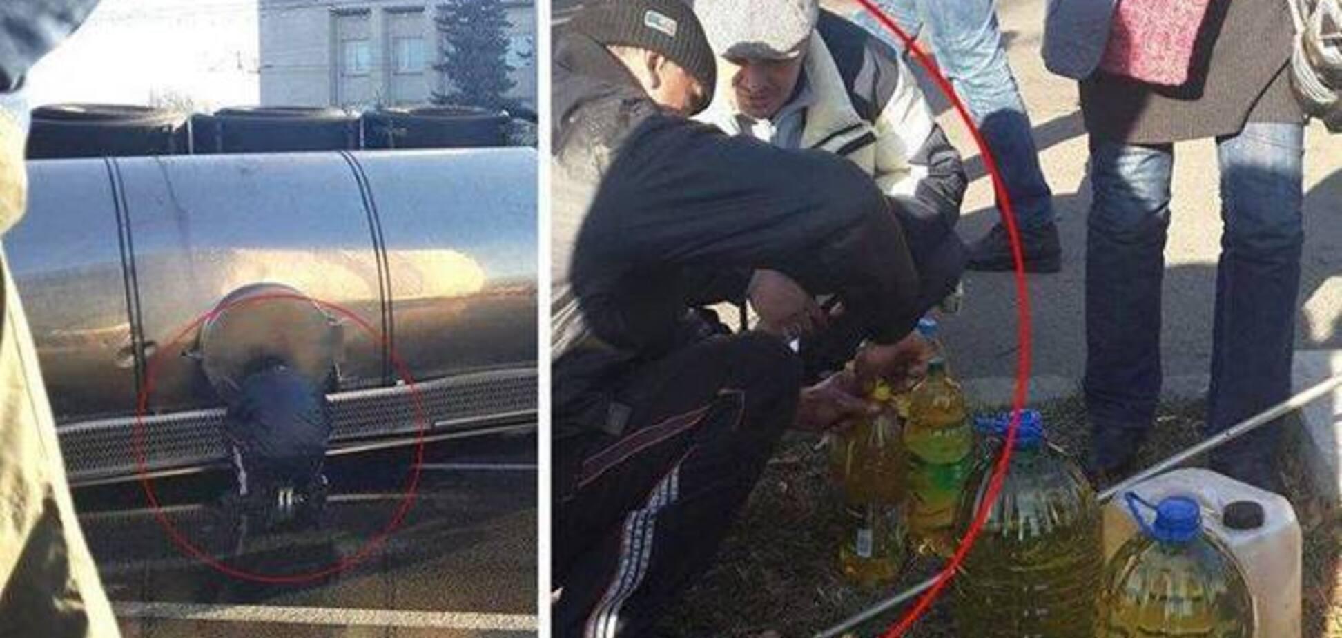 'Любители халявы' прямо на месте аварии в Киеве крадут подсолнечное масло: опубликованы фото