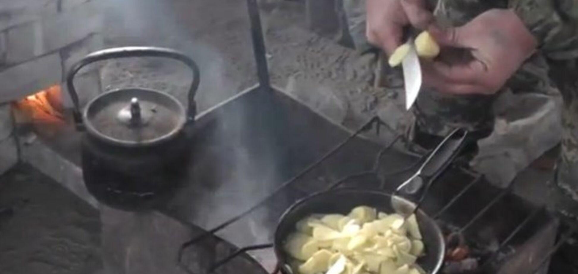 Росіянка зняла на відео, як українські солдати смажать картоплю з м'ясом 'російськомовних немовлят'