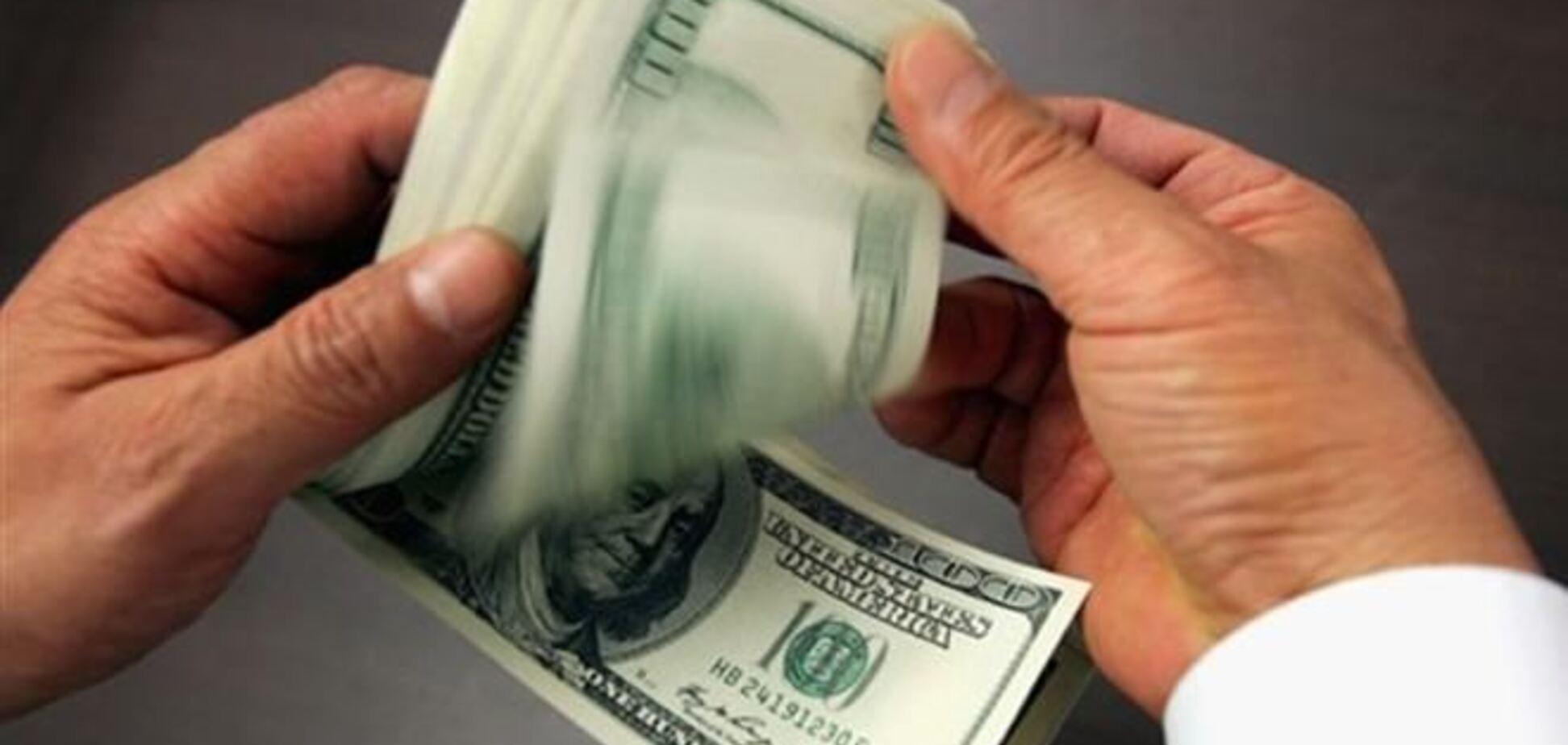 Гривня укрепляется: официальный курс доллара 9,69