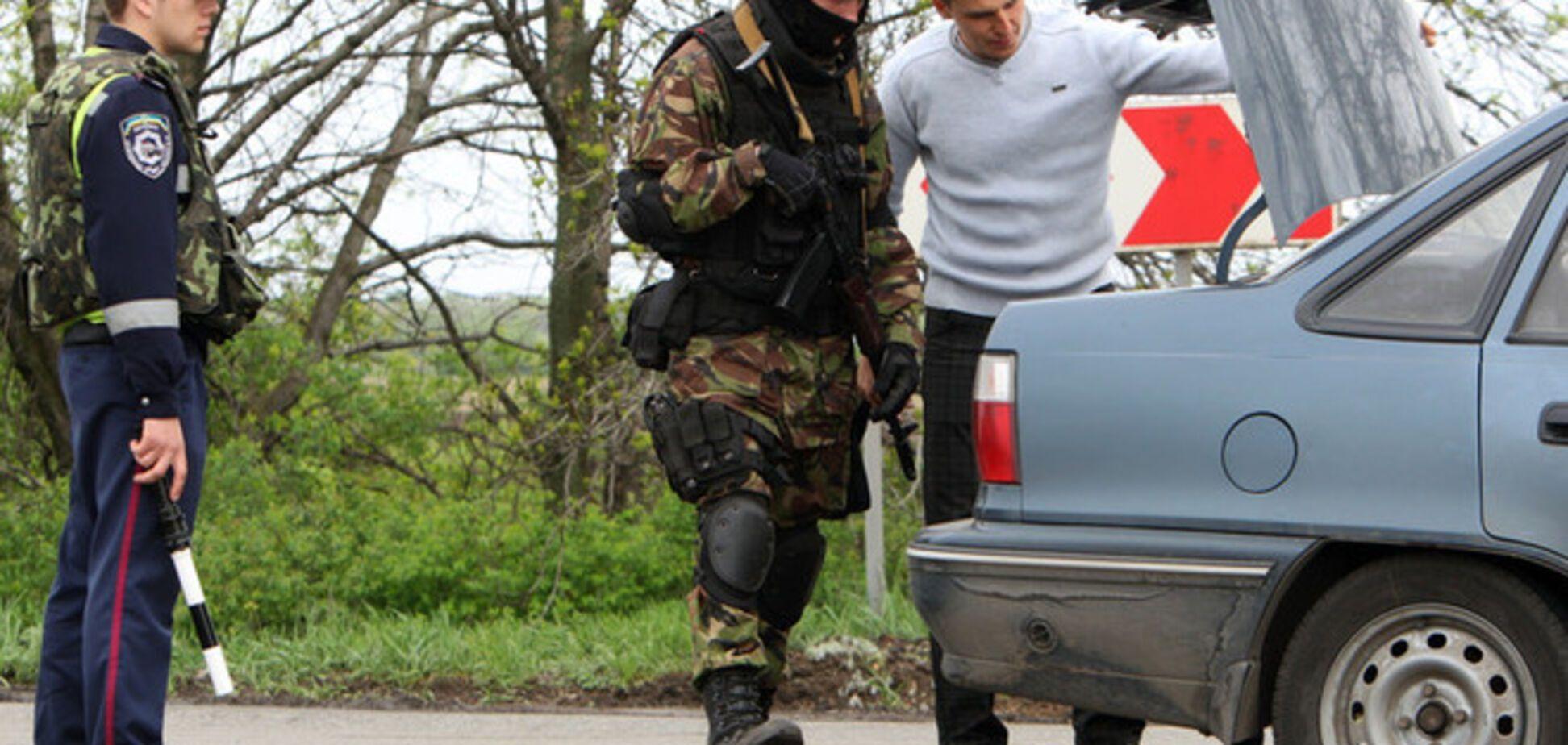 На блокпосту вблизи Изюма задержали россиян с битами и 200 тыс грн