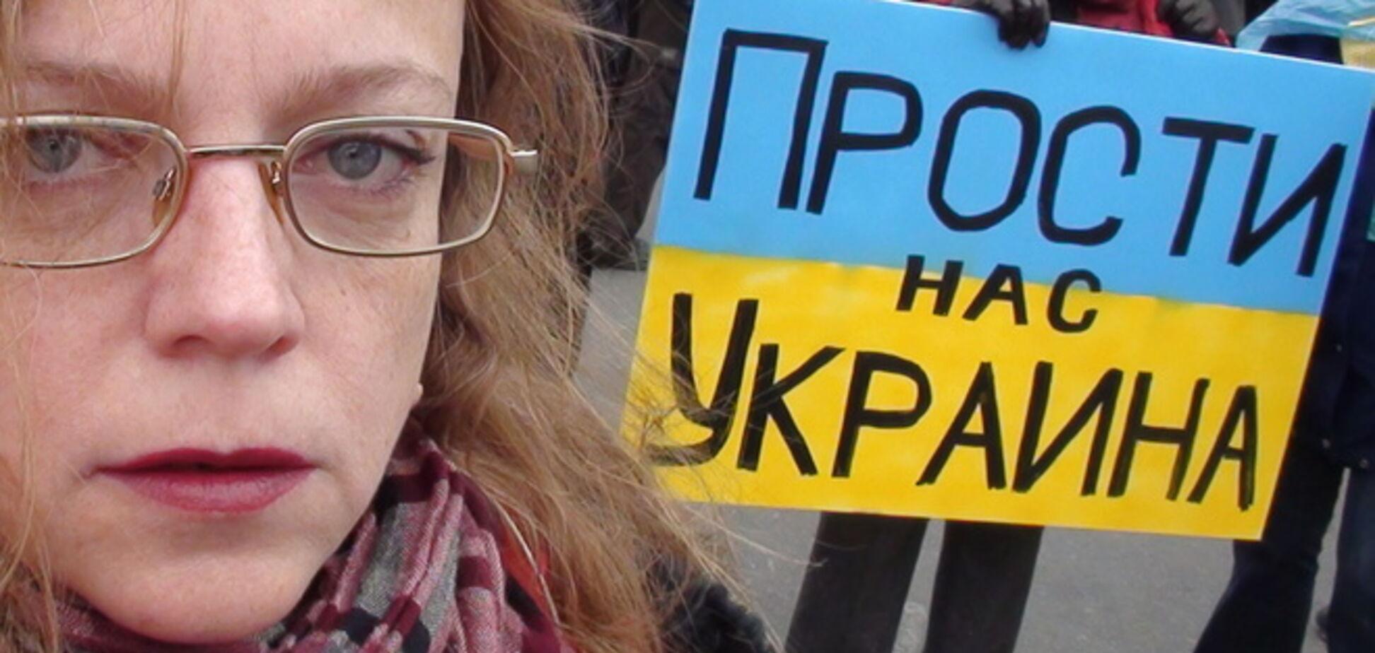 Около 20 россиян вышли к посольству Украины в Москве в вышиванках и с плакатом 'Пробачте нас'