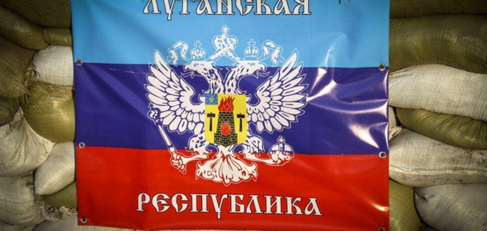 Террористы в Луганске уже пометили элитное жилье надписями 'собственность ЛНР'