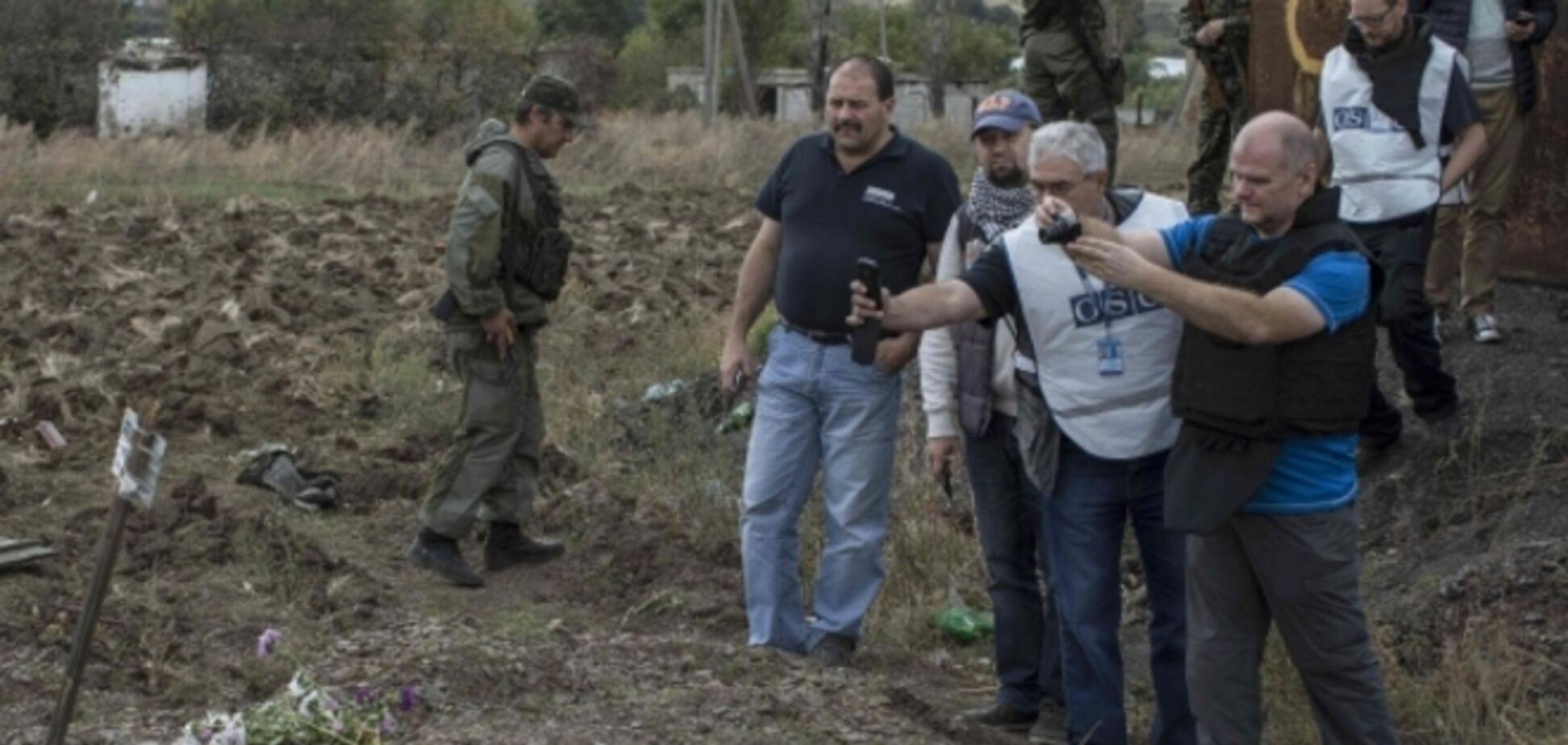 'Умер за ложь Путина': ОБСЕ обнаружила на Донбассе массовые захоронения