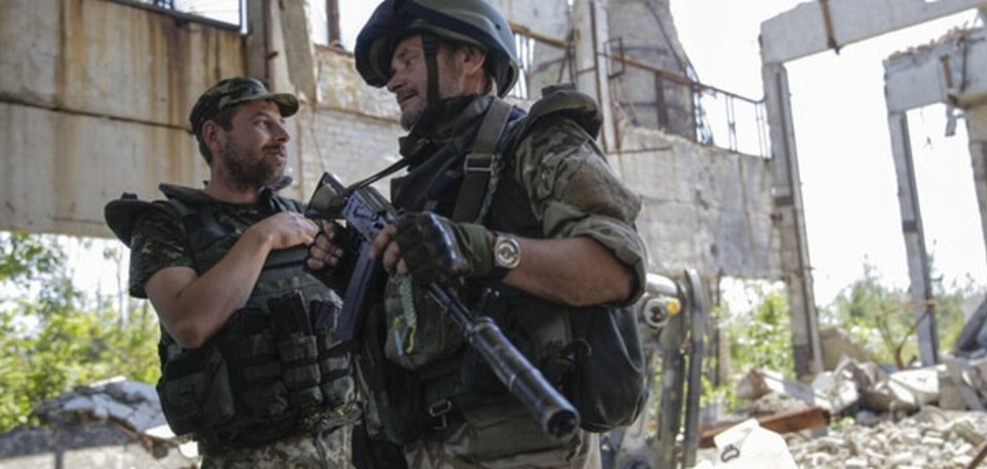 Україна почала відведення озброєння у зоні АТО