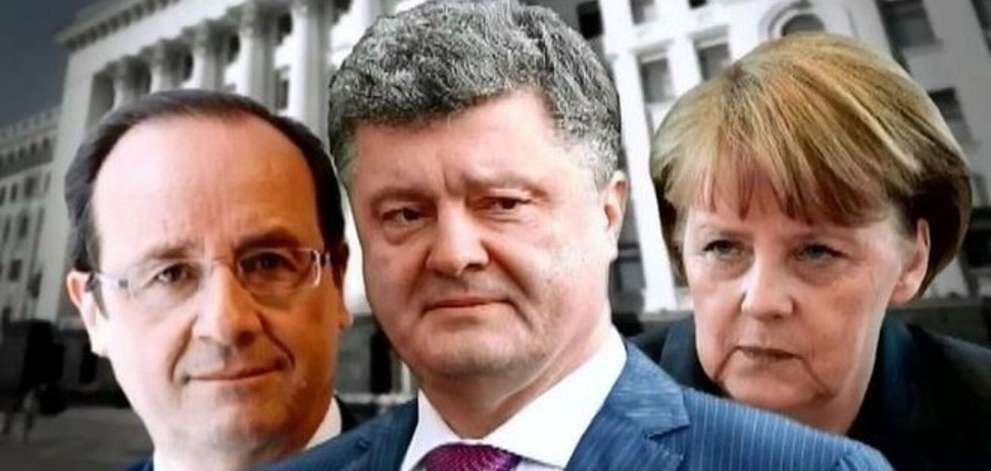 Порошенко, Олланд и Меркель обсудили по телефону несостоявшееся 'перемирие' в Дебальцево