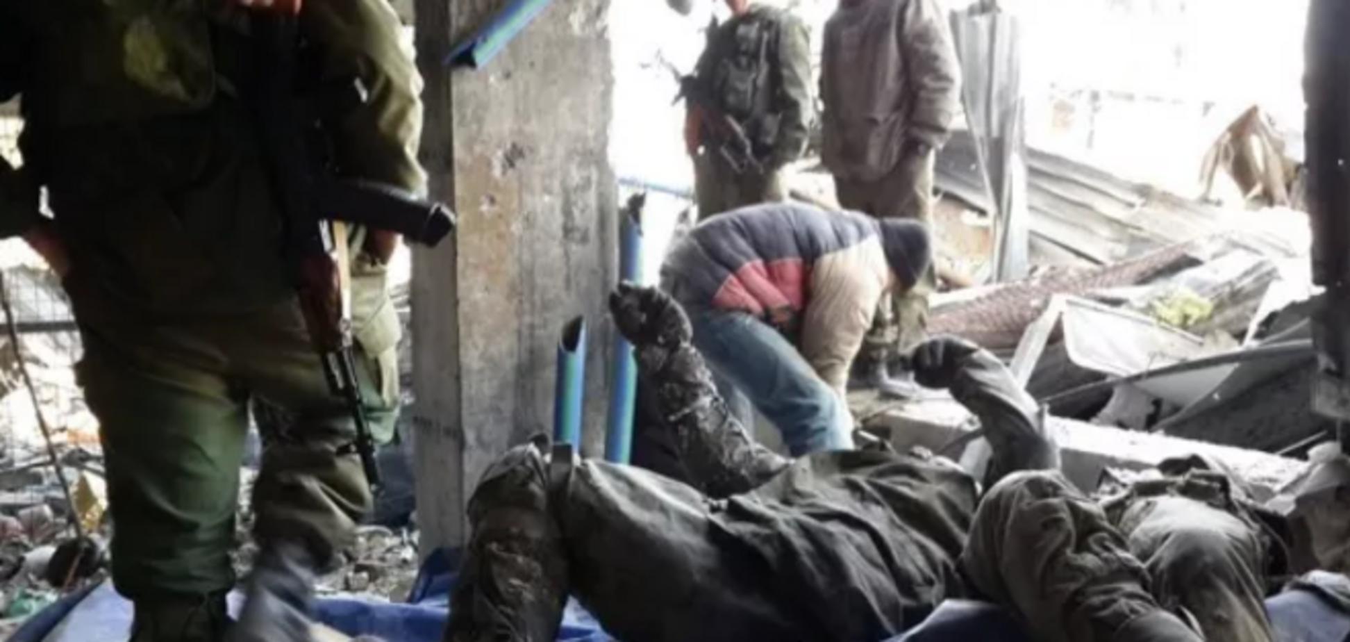 В донецком аэропорту нашли тела семи погибших 'киборгов': фотофакт