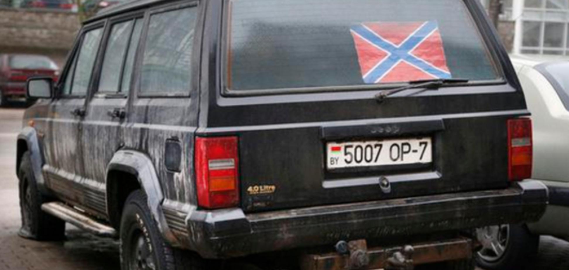 В Минске белорусы прокололи колеса джипу с флагом 'Новороссии': фотофакт