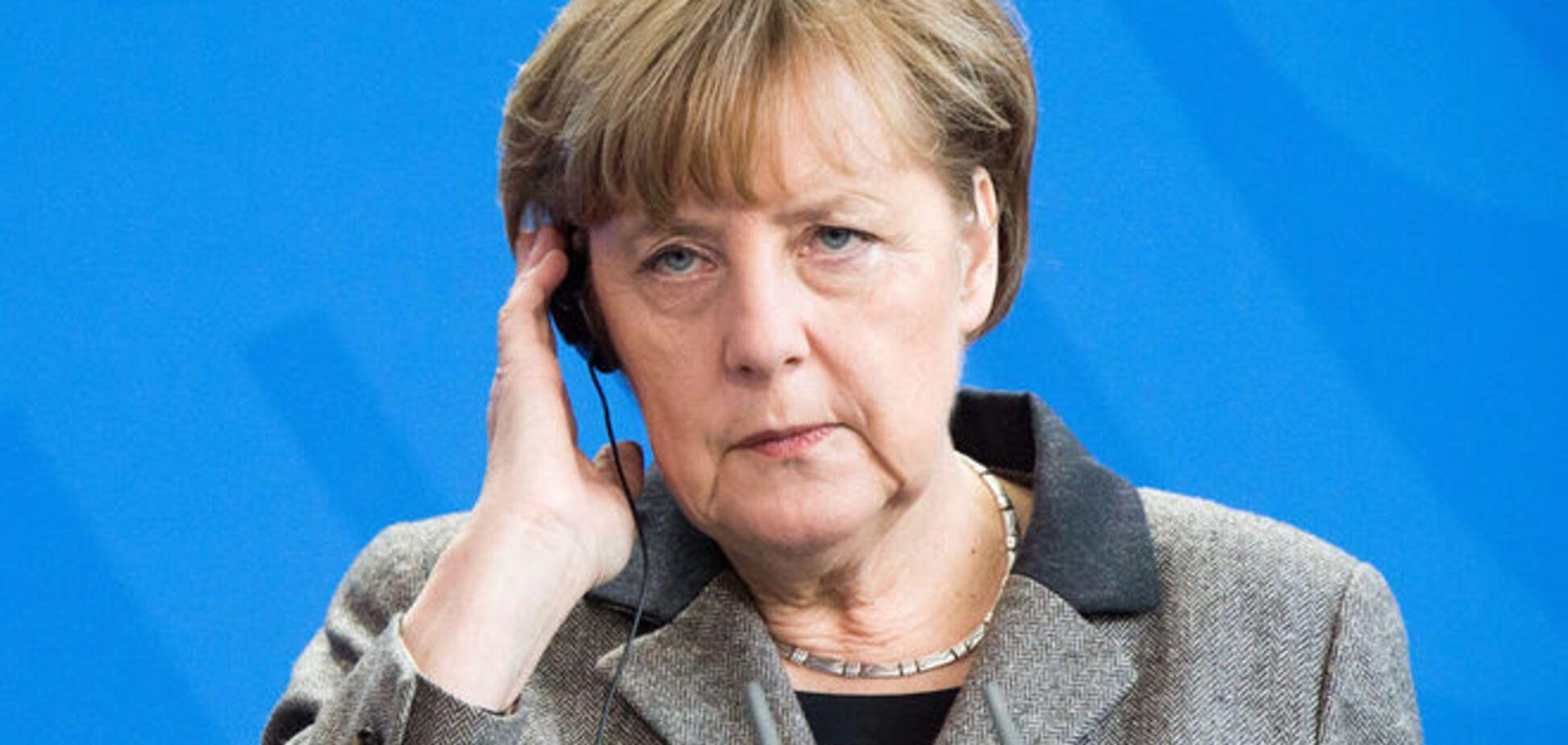 Меркель потрясена 'подлым убийством' Немцова и ждет от Путина гарантий правосудия