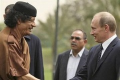 Путин и Каддафи