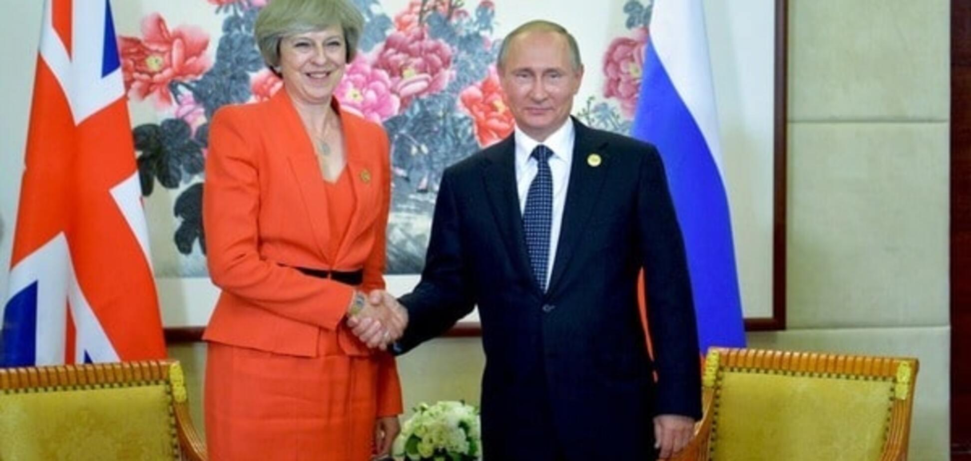 Мэй и Путин поговорили 'откровенно' после инцидента с рукопожатием