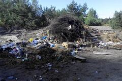 Участникам АТО выделили землю на мусорнике...