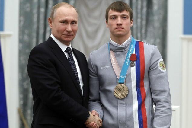 Очередной призер Олимпиады решил избавиться от распиаренного подарка Путина