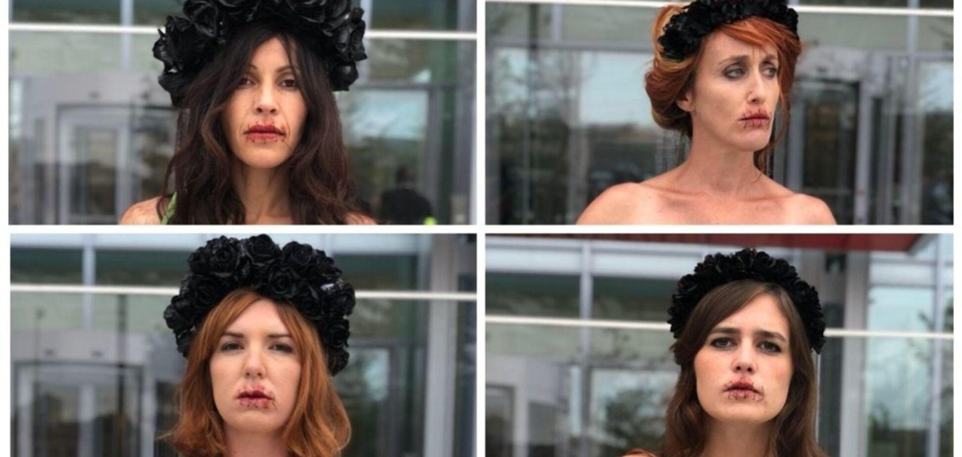 С зашитыми ртами: голые женщины вышли на акцию в Париже из-за России. Фотофакт
