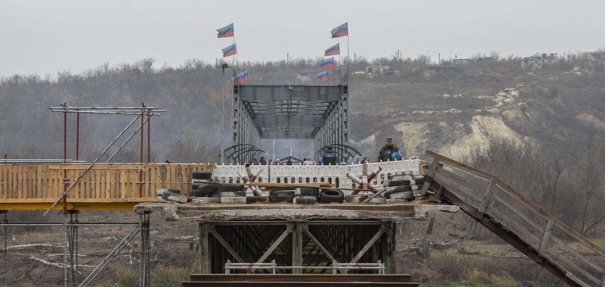 'ЛНР' продовжила провокацію з прапорами на мосту