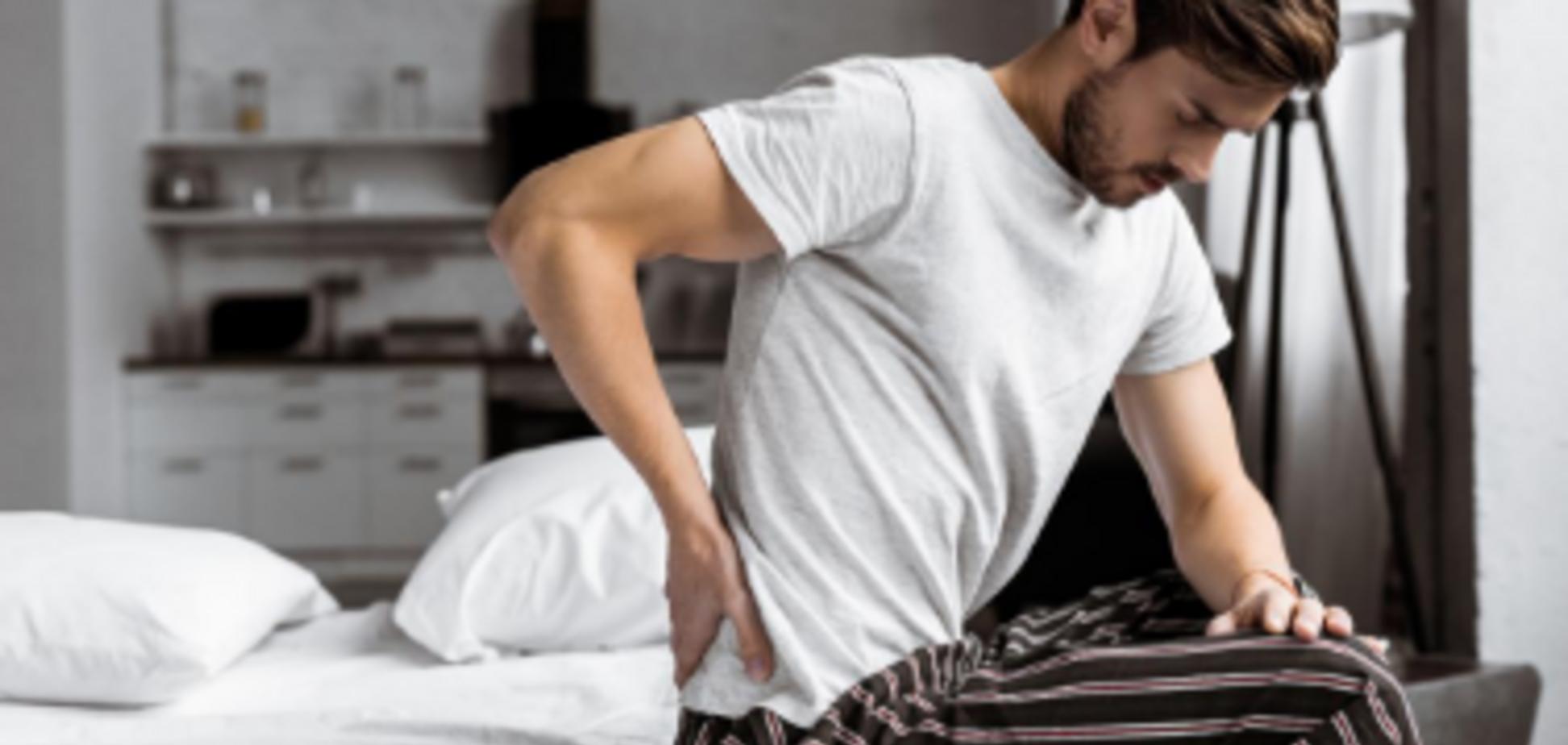 Біль в попереку у чоловіків: названі основні причини