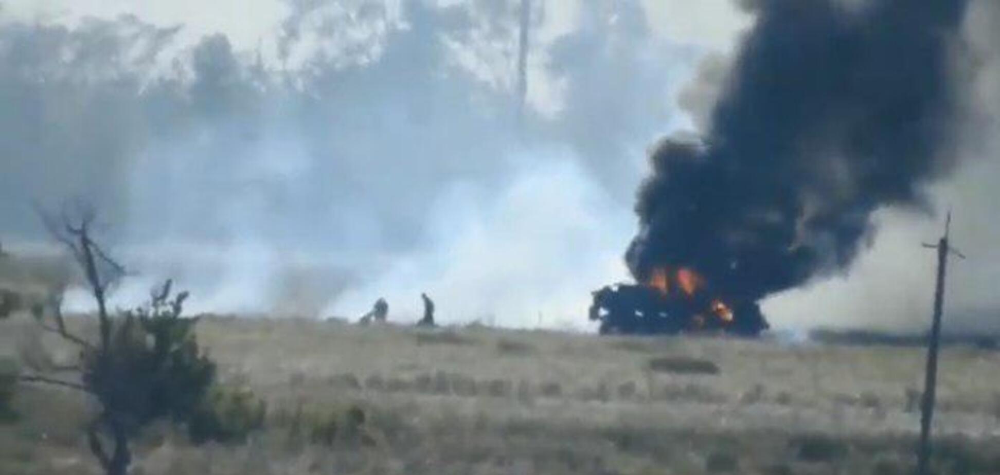 Кадр с постановочного видео террористов