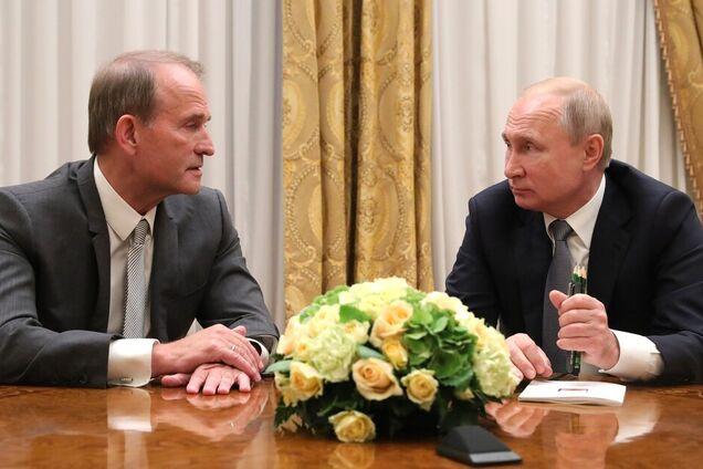 Володимир Путін, Віктор Медведчук на зустрічі в Санкт-Петербурзі 18 липня 2019 року