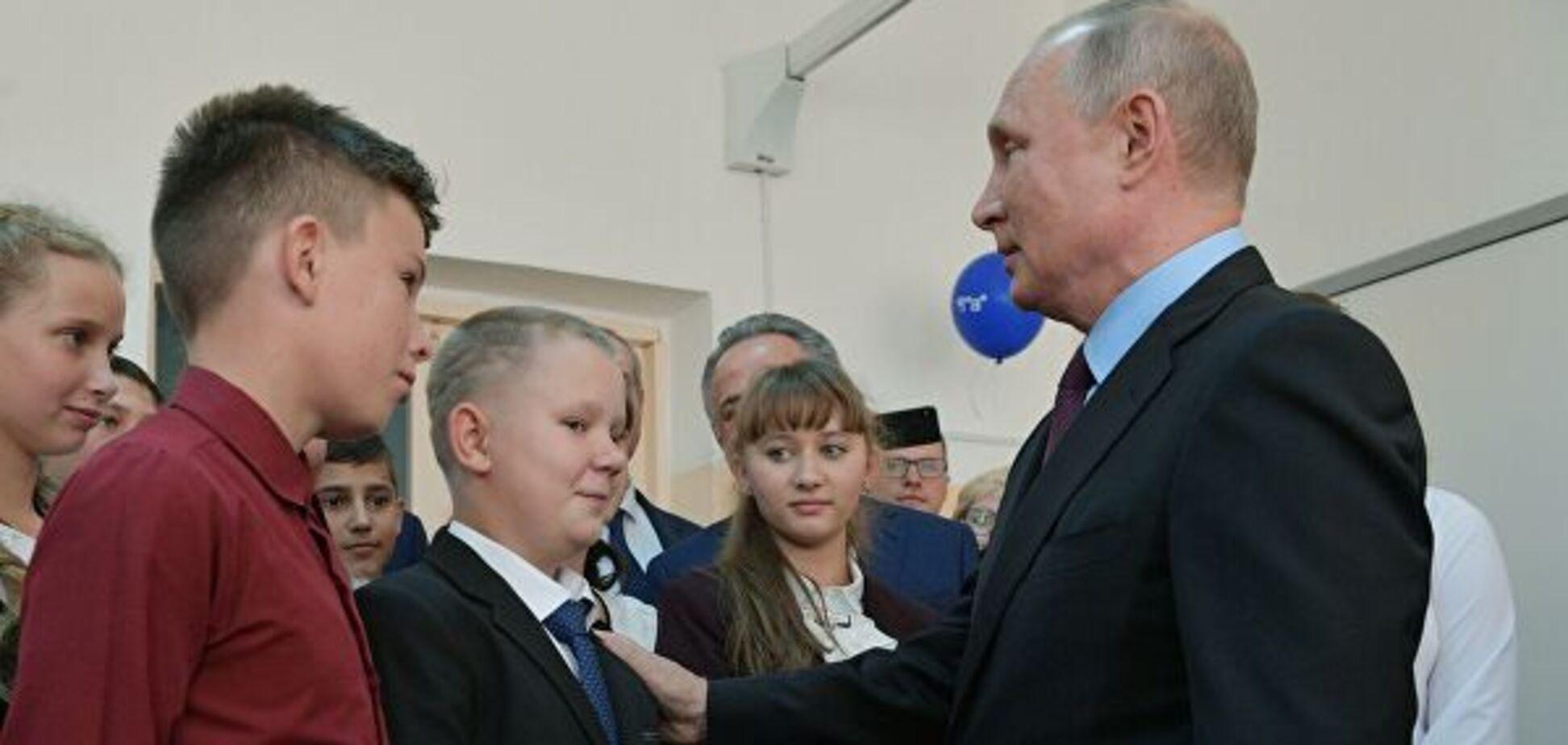 Владимир Путин и мальчик