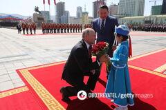 'О внуках мечтает': Путина снова застали за поцелуем с ребенком