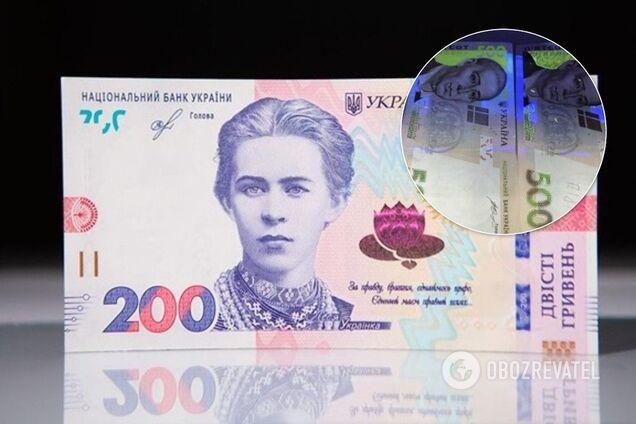 Національний банк України повідомив, що є низка способів відрізнити справжні гроші від підроблених