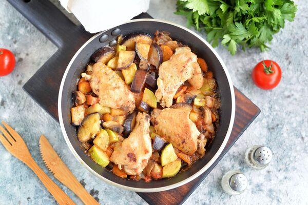 Тушковані стегенця з овочами