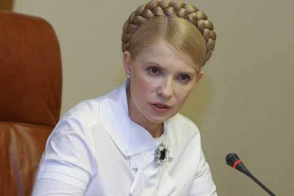 """Тимошенко рапортует о перевыполнении """"нереального"""" бюджета"""