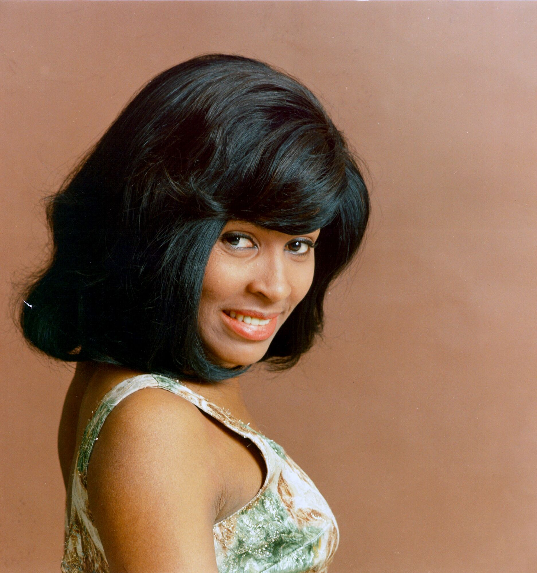 an analysis of the life and biography of anna mae bullock tina turner an american singer