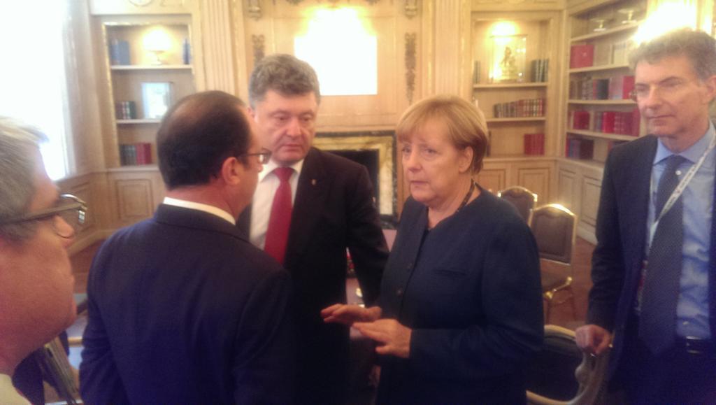 Путин покинул совещание, Порошенко остался с Меркель и Олландом: опубликованы фото