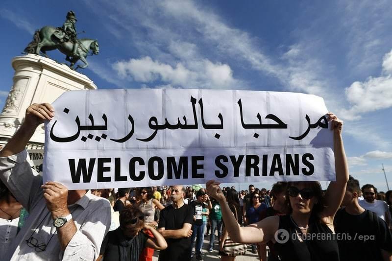 """Европа взорвалась акциями """"за"""" и """"против"""" мигрантов: фоторепортаж"""