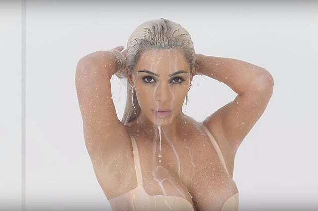 Полуголую Кардашьян облили молоком в новом клипе Ферги: опубликовано видео