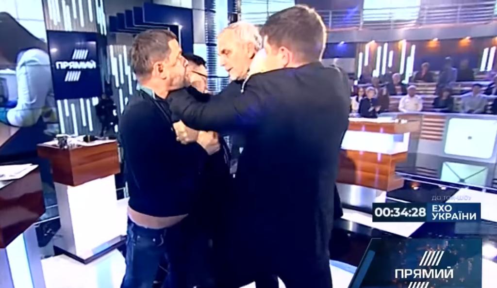 Вцепился в шею: нардеп устроил жесткую драку в прямом эфире