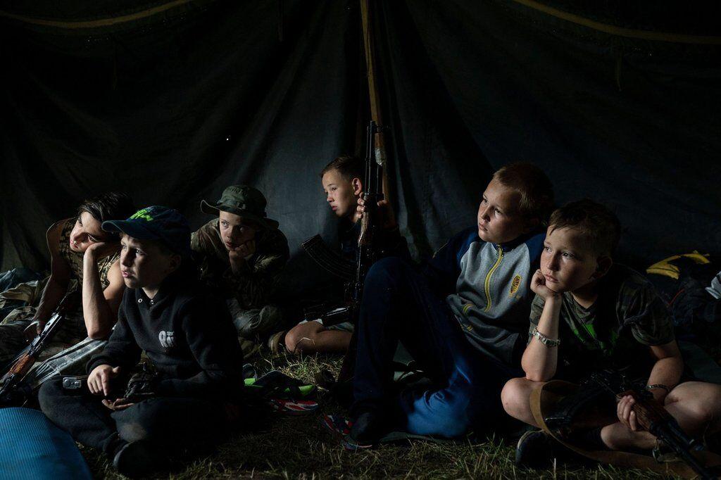 Донбасс и дети с оружием: фото об Украине попали в топ-100 по версии Time