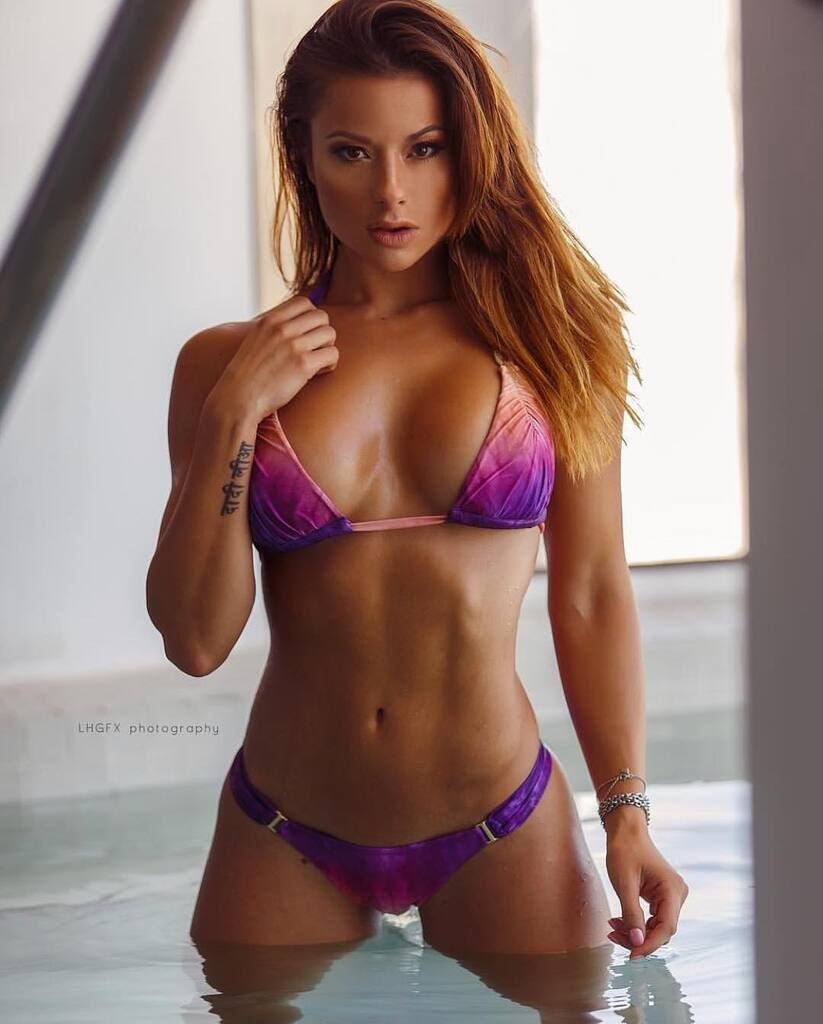 Young redhead fitness model nude