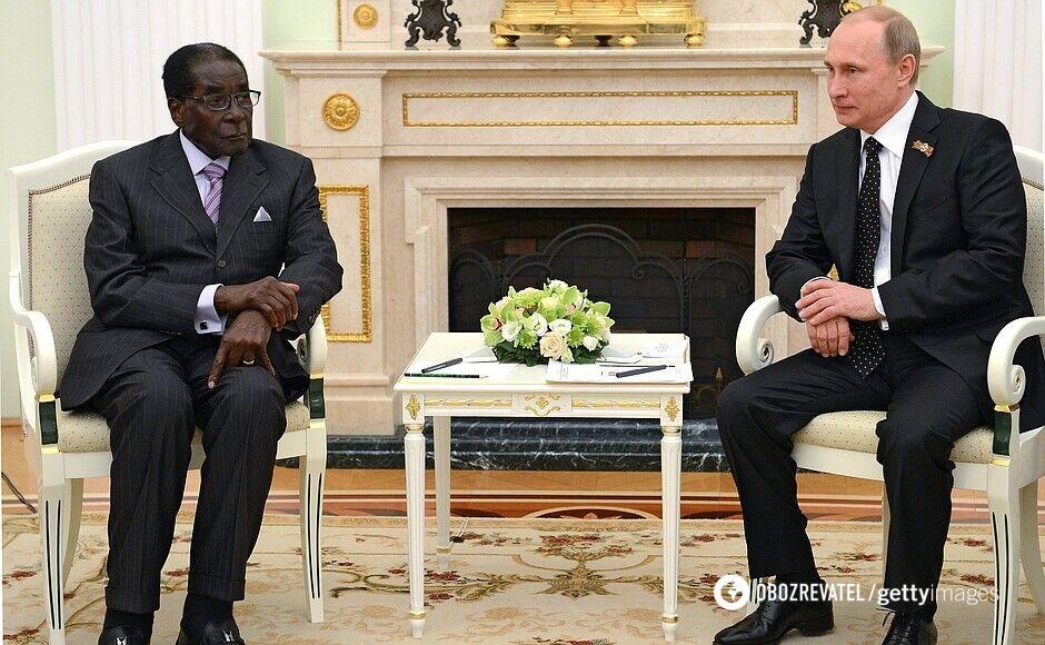 Роберт Мугабе і Володимир Путін