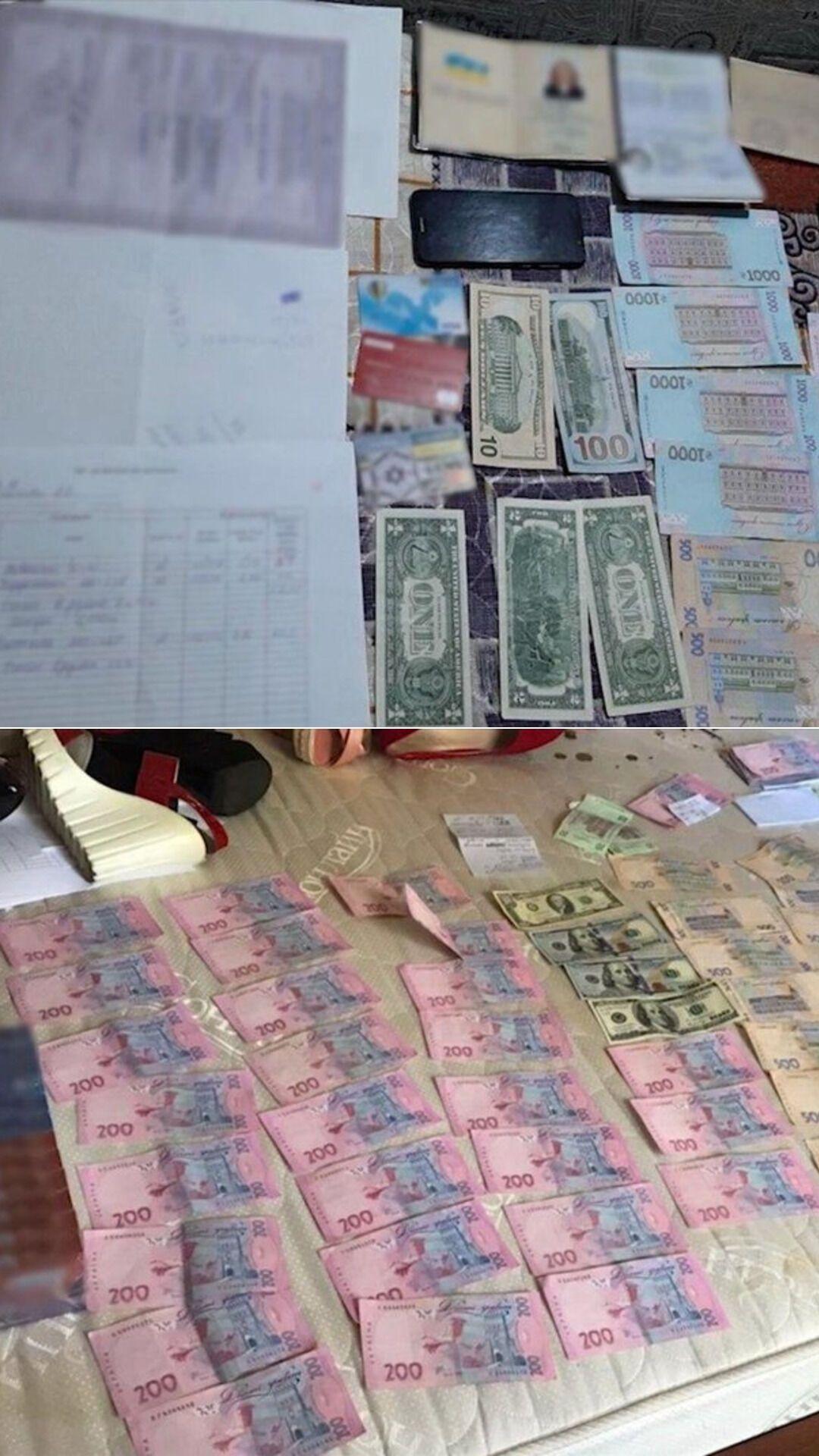Гроші, які вилучили у фігурантів злочинної групи