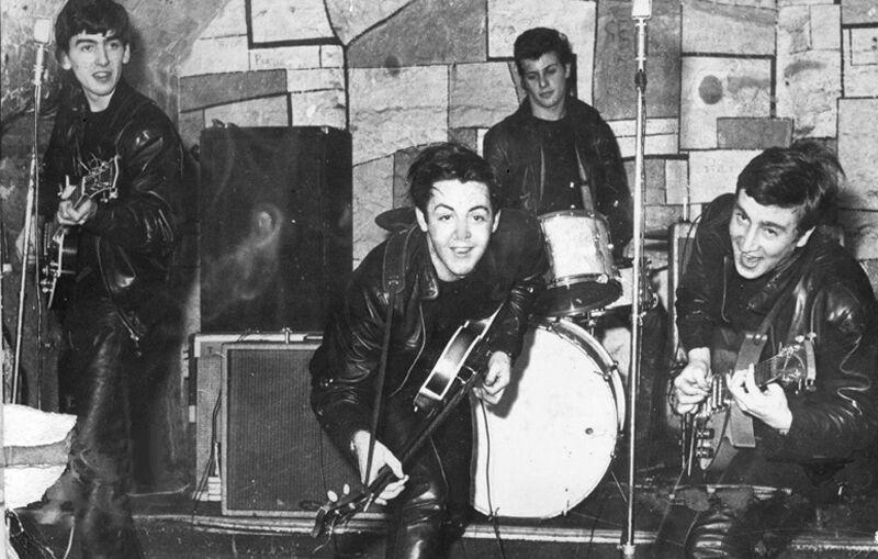 The Beatles во время одного из концертов.
