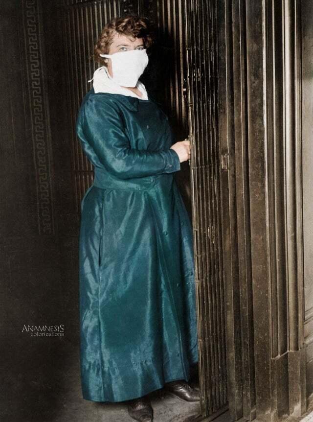 Женщина-лифтер в маске для защиты от испанского гриппа, Нью-Йорк (США), 16 октября 1918 года