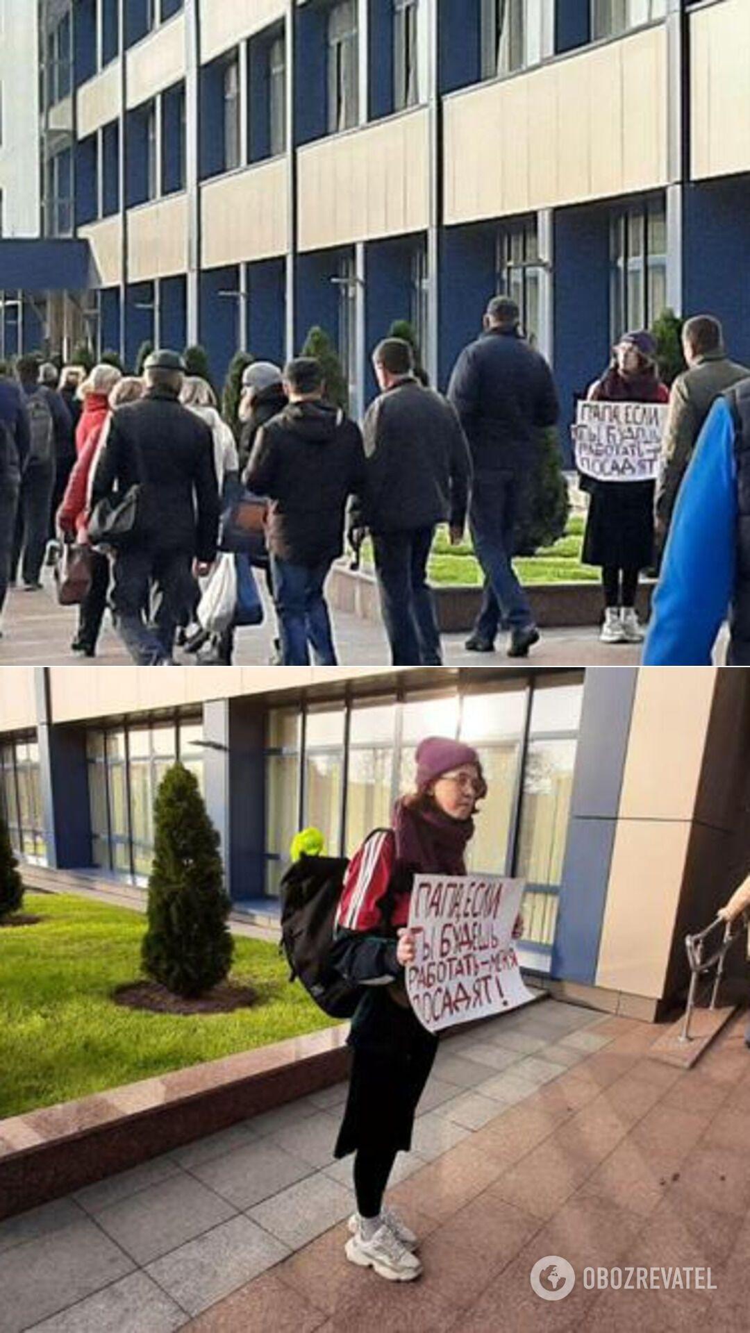 Девушка с плакатом у здания БелАЗа в Жодино