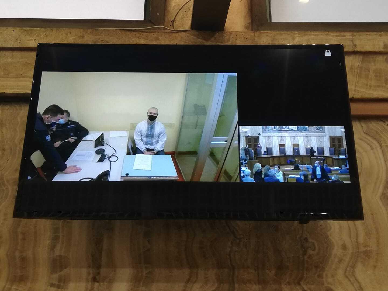 Маркив следит за процессом по видеосвязи