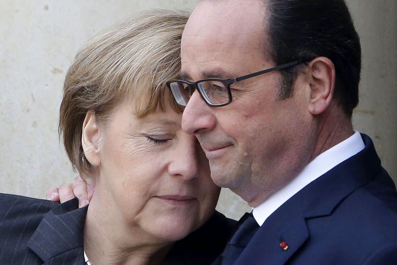 Ангела Меркель і президент Франції Франсуа Олланд у Парижі після терористичної атаки на редакцію журналу Charlie Hebdo