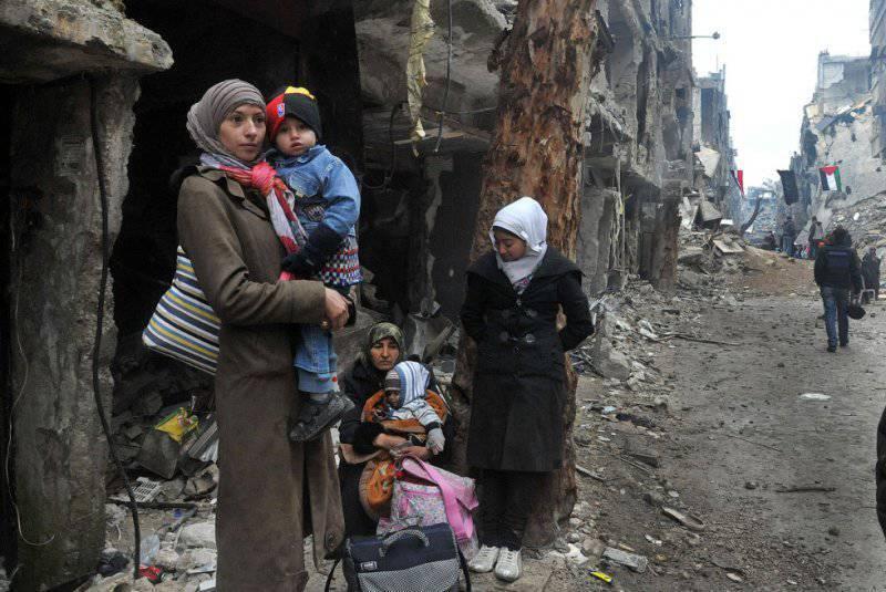 Беженцы на окраине сирийской столицы Дамаск, февраль 2014 года