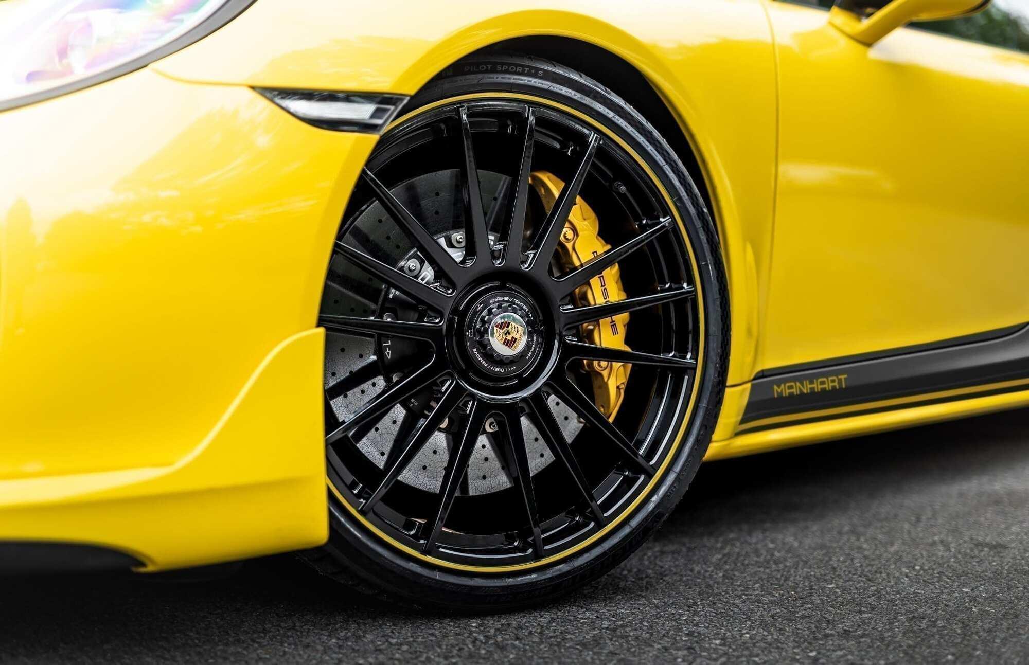 Manhart TR850 получил 21-дюймовые ажурные диски Levella и шины Michelin Pilot Sport 4 S размерностью 255/30 спереди и 325/25 – сзади. Фото: