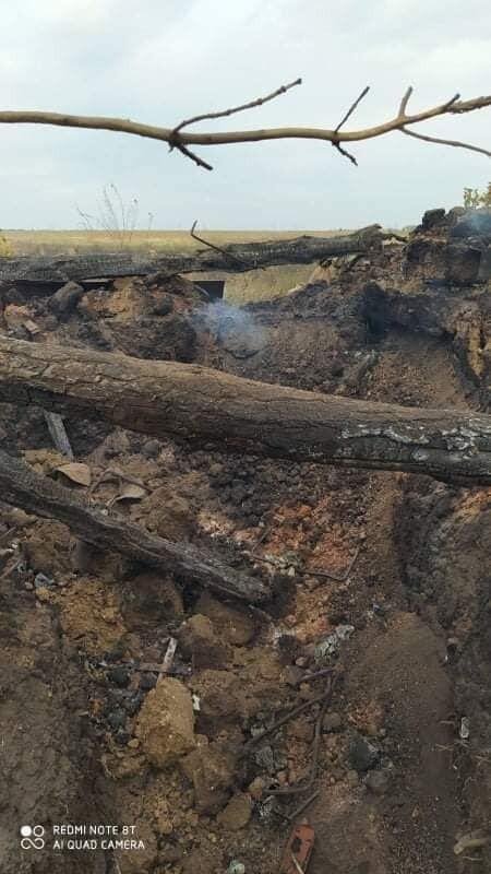 Последствия пожара на позициях ОС на Донбассе.