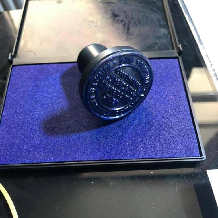 Печатка, знайдена під час обшуку.